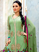 Let your personality articulate for you with this designer embroidery suit. The dazzling light green net kameez have amazing embroidery patch work is done with resham, zari and stone work. Embroidery work on kameez is stunning. This is perfect party wear suit. The entire ensemble makes an excellent wear. Matching churidar and dupatta is available with this suit. Slight Color variations are possible due to differing screen and photograph resolutions.