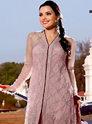 You can be sure that ethnic fashions selections of clothing are taken from the latest trend in today's fashion. The dazzling light onion pink net kameez have amazing embroidery patch work is done with resham work. Embroidery work on kameez is stunning. This is perfect party wear suit. The entire ensemble makes an excellent wear. Matching churidar and dusty maroon dupatta is available with this suit. Slight Color variations are possible due to differing screen and photograph resolutions.