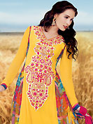 Ultimate collection of embroidered suits with fabulous style. The dazzling yellow faux georgette churidar suit have amazing abstract print and embroidery patch work is done with resham and lace work. The entire ensemble makes an excellent wear. Contrasting red churidar and dupatta is available with this suit. Slight Color variations are possible due to differing screen and photograph resolutions.