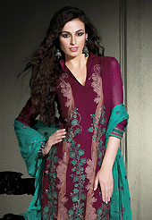 Era with extension in fashion, style, Grace and elegance have developed grand love affair with this ethnical wear. The dazzling burgundy georgette churidar suit have amazing embroidery patch work is done with resham work. Embroidery work on kameez is stunning. This is perfect party wear suit. The entire ensemble makes an excellent wear. Matching churidar and contrasting turquoise green dupatta is available with this suit. Slight Color variations are possible due to differing screen and photograph resolutions.