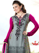 Try out this year top trend, glowing, bold and natural collection. The dazzling grey georgette churidar suit have amazing floral print and embroidery patch work is done with resham and lace work. Embroidery work on kameez is stunning. This is perfect party wear suit. The entire ensemble makes an excellent wear. Contrasting deep pink churidar and matching dupatta is available with this suit. Slight Color variations are possible due to differing screen and photograph resolutions.