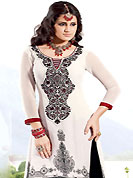 Exquisite combination of color, fabric can be seen here. The dazzling white georgette churidar suit have amazing embroidery patch work is done with resham and lace work. Embroidery work on kameez is stunning. This is perfect party wear suit. The entire ensemble makes an excellent wear. Contrasting red churidar and black dupatta is available with this suit. Slight Color variations are possible due to differing screen and photograph resolutions.