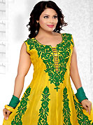 Style and trend will be at the peak of your beauty when you adorn this suit. The dazzling yellow and green net readymade churidar kameez have amazing embroidery patch work is done with resham and zari work. The entire ensemble makes an excellent wear. Contrasting green butter crepe churidar and double dye chiffon dupatta is available with this suit. Slight Color variations are possible due to differing screen and photograph resolutions.