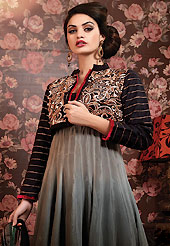 Breathtaking collection of suits with stylish embroidery work and fabulous style. The dazzling shaded grey and black chiffon churidar suit have amazing embroidery patch work is done with resham, zari, stone and lace work. Beautiful embroidery work on kameez is stunning. The entire ensemble makes an excellent wear. Contrasting red santoon churidar and black chiffon dupatta is available with this suit. Slight Color variations are possible due to differing screen and photograph resolutions.