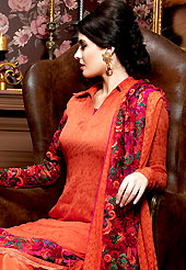 A desire that evokes a sense of belonging with a striking details. The dazzling dark orange chiffon churidar suit have amazing embroidery patch work is done with resham work. Beautiful embroidery work on kameez is stunning. The entire ensemble makes an excellent wear. Matching santoon churidar and embroidered work chiffon dupatta is available with this suit. Slight Color variations are possible due to differing screen and photograph resolutions.