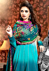 Breathtaking collection of suits with stylish embroidery work and fabulous style. The dazzling shaded teal blue and beige chiffon churidar suit have amazing embroidery patch work is done with resham and applique work. Beautiful embroidery work on kameez is stunning. The entire ensemble makes an excellent wear. Matching teal blue santoon churidar and chiffon dupatta is available with this suit. Slight Color variations are possible due to differing screen and photograph resolutions.
