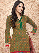 Ultimate collection of embroidered suits with fabulous style. The dazzling orange and green cotton silk churidar suit have amazing abstract, geometric print, self weaving and jacquard patch work. The entire ensemble makes an excellent wear. Matching green churidar and maroon dupatta is available with this suit. Slight Color variations are possible due to differing screen and photograph resolutions.