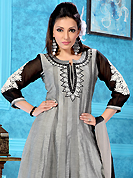 Try out this year top trend, glowing, bold and natural collection. The dazzling grey cotton churidar suit have amazing embroidery patch work is done with resham, mirror and lace work. The entire ensemble makes an excellent wear. Contrasting black churidar and double dye dupatta is available with this suit. Slight Color variations are possible due to differing screen and photograph resolutions.