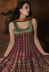 Embroidered suits are the best choice for a girl to enhance her feminine look. The dazzling burgundy and dark green banarasi brocade readymade churidar suit have amazing embroidery patch work is done with resham, zari and lace work. The entire ensemble makes an excellent wear. Matching dark green santoon churidar and dark green net dupatta is available with this suit. Slight Color variations are possible due to differing screen and photograph resolutions.