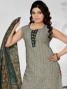 Get ready to sizzle all around you by sparkling suit. The dazzling off white and black cotton readymade salwar kameez have amazing geometric print and embroidery patch work is done with resham, thread and sequins work. The entire ensemble makes an excellent wear. Contrasting red printed cotton salwar and teal green printed cotton dupatta is available with this suit. Slight Color variations are possible due to differing screen and photograph resolutions.