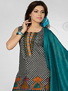 The most beautiful refinements for style and tradition. The dazzling black and off white cotton readymade salwar kameez have amazing floral, geometric print and patch work. The entire ensemble makes an excellent wear. Contrasting turquoise cotton salwar and red and cotton dupatta is available with this suit. Slight Color variations are possible due to differing screen and photograph resolutions.