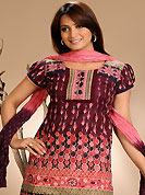Look stunning rich with dark shades and floral patterns. The dazzling white and black cotton readymade salwar kameez have amazing floral, abstract print and patch work. The entire ensemble makes an excellent wear. Matching pink cotton salwar and shaded dupatta is available with this suit. Slight Color variations are possible due to differing screen and photograph resolutions.