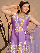 An occasion wear perfect is ready to rock you. The dazzling light purple cotton readymade churidar suit have amazing embroidery patch work is done with resham and lace work. The entire ensemble makes an excellent wear. Matching churidar and net dupatta is available with this suit. Slight Color variations are possible due to differing screen and photograph resolutions.