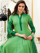 Take the fashion industry by storm in this beautiful embroidered suit. The dazzling aloe vera green faux georgette readymade churidar suit have amazing embroidery patch work is done with resham work. The entire ensemble makes an excellent wear. Matching churidar and dupatta is available with this suit. Slight Color variations are possible due to differing screen and photograph resolutions.