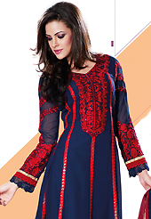 An occasion wear perfect is ready to rock you. The dazzling navy blue faux georgette churidar suit have amazing embroidery patch work is done with resham, sequins and lace work. Beautiful embroidery work on kameez is stunning. The entire ensemble makes an excellent wear. Contrasting red santoon churidar and red net dupatta is available with this suit. Slight Color variations are possible due to differing screen and photograph resolutions.