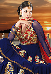 Get ready to sizzle all around you by sparkling suit. The dazzling navy blue faux georgette anarkali churidar suit have amazing embroidery patch work is done with resham, zari, sequins, stone and lace work. Beautiful embroidery work on kameez is stunning. The entire ensemble makes an excellent wear. Matching santoon churidar and red net dupatta is available with this suit. Slight Color variations are possible due to differing screen and photograph resolutions.