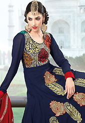 Take a look on the changing fashion of the season. The dazzling navy blue faux georgette churidar suit have amazing embroidery patch work is done with resham, zari and sequins work. Beautiful embroidery work on kameez is stunning. The entire ensemble makes an excellent wear. Matching santoon churidar and red faux chiffon dupatta is available with this suit. Slight Color variations are possible due to differing screen and photograph resolutions.