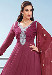 The fascinating beautiful subtly garment with lovely patterns. The dazzling burgundy faux georgette churidar suit have amazing embroidery patch work is done with resham, zari and sequins work. Beautiful embroidery work on kameez is stunning. The entire ensemble makes an excellent wear. Matching santoon churidar and dupatta is available with this suit. Slight Color variations are possible due to differing screen and photograph resolutions.