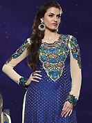 The color range from natural shades looks ravishing. The dazzling royal blue art silk salwar kameez have amazing embroidery patch work is done with resham, zari and stone work. Beautiful embroidery work on kameez is stunning. The entire ensemble makes an excellent wear. Contrasting light cream faux georgette salwar and shaded dupatta is available with this suit. Slight Color variations are possible due to differing screen and photograph resolutions.
