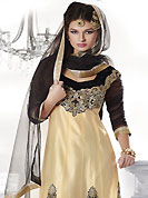 Take the fashion industry by storm in this beautiful embroidered suit. The dazzling cream and black net churidar suit have amazing embroidery patch work is done with resham, zari and lace work. Beautiful embroidery work on kameez is stunning. The entire ensemble makes an excellent wear. Contrasting black santoon churidar and black net dupatta is available with this suit. Slight Color variations are possible due to differing screen and photograph resolutions.