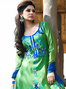 Get ready to sizzle all around you by sparkling suit. The dazzling green chanderi cotton readymade churidar suit have amazing embroidery patch work is done with resham work. Beautiful embroidery work on kameez is stunning. The entire ensemble makes an excellent wear. Matching churidar and dupatta is available with this suit. Slight Color variations are possible due to differing screen and photograph resolutions.