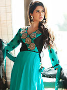 It is color this season and bright shaded suits are really something that is totally in vogue. The dazzling sky blue faux georgette readymade churidar suit have amazing embroidery patch work is done with applique and beads work. Beautiful embroidery work on kameez is stunning. The entire ensemble makes an excellent wear. Matching churidar and shaded net dupatta is available with this suit. Slight Color variations are possible due to differing screen and photograph resolutions.