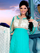 This season dazzle and shine in pure colors. The dazzling aqua blue net readymade churidar suit have amazing embroidery patch work is done with zardosi, sequins, stone, beads and cutbeads work. Beautiful embroidery work on kameez is stunning. The entire ensemble makes an excellent wear. Matching churidar and off white net dupatta is available with this suit. Slight Color variations are possible due to differing screen and photograph resolutions.