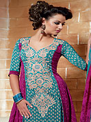 The glamorous silhouette to meet your most dire fashion needs. The dazzling turquoise blue and magenta crepe churidar suit have amazing floral print and embroidery patch work is done with resham, zari and beads work. The entire ensemble makes an excellent wear. Matching magenta churidar and printed dupatta is available with this suit. Slight Color variations are possible due to differing screen and photograph resolutions.