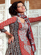 This season dazzle and shine in pure colors. The dazzling dark orange and light grey crepe churidar suit have amazing floral print and embroidery patch work is done with resham, zari and beads work. The entire ensemble makes an excellent wear. Matching light grey churidar and printed dupatta is available with this suit. Slight Color variations are possible due to differing screen and photograph resolutions.