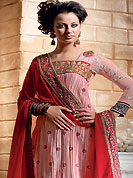 The glamorous silhouette to meet your most dire fashion needs. The dazzling pink crush crepe churidar suit have amazing floral print and embroidery patch work is done with resham, zari, sequins and applique work. The entire ensemble makes an excellent wear. Contrasting red churidar and dupatta is available with this suit. Slight Color variations are possible due to differing screen and photograph resolutions.