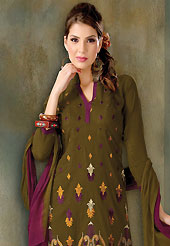 A desire that evokes a sense of belonging with a striking details. This dark olive green cotton churidar suit have amazing embroidery and patch work is done with resham work. Embroidery on kameez is highlighting the beauty of this suit. Contrasting dark purple churidar and double dye chiffon dupatta come along with this suit. Slight Color variations are possible due to differing screen and photograph resolutions.