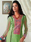 Get ready to sizzle all around you by sparkling suit. The dazzling pastel green cotton jacquard salwar kameez have amazing embroidery patch work is done with resham work. Beautiful embroidery work on kameez is stunning. Matching printed salwar and turquoise printed chiffon dupatta is available with this suit. Slight Color variations are possible due to differing screen and photograph resolutions.