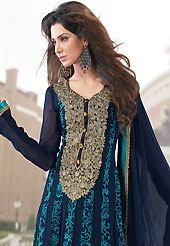 An occasion wear perfect is ready to rock you. The dazzling navy blue faux georgette churidar suit have amazing floral print and embroidery patch work is done with resham, zari and lace work. Beautiful embroidery work on kameez is stunning. The entire ensemble makes an excellent wear. Matching light blue churidar and navy blue dupatta is available with this suit. Slight Color variations are possible due to differing screen and photograph resolutions.
