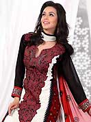 Dreamy variation on shape and forms compliment your style with tradition. The dazzling off white and black georgette churidar suit have amazing embroidery patch bordered work is done with resham, zari and lace work. Beautiful embroidery work on kameez is stunning. The entire ensemble makes an excellent wear. Contrasting red churidar and double dye dupatta is available with this suit. Slight Color variations are possible due to differing screen and photograph resolutions.