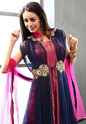An occasion wear perfect is ready to rock you. The dazzling navy blue and dark pink net and brocade readymade churidar suit have amazing embroidery patch work is done with cutdana, zardosi, stone and beads work. Beautiful embroidery work on kameez is stunning. The entire ensemble makes an excellent wear. Matching dark pink santoon churidar and dark pink net dupatta is available with this suit. Slight Color variations are possible due to differing screen and photograph resolutions.