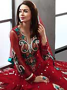 The glamorous silhouette to meet your most dire fashion needs. The dazzling dark red net readymade churidar suit have amazing embroidery patch work is done with resham, zari, stone and lace work. Beautiful embroidery work on kameez is stunning. The entire ensemble makes an excellent wear. Matching churidar and dupatta is available with this suit. Slight Color variations are possible due to differing screen and photograph resolutions.