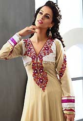 Embroidered suits are the best choice for a girl to enhance her feminine look. The dazzling dark cream georgette readymade churidar suit have amazing embroidery patch work is done with resham, zari, stone and lace work. Beautiful embroidery work on kameez is stunning. The entire ensemble makes an excellent wear. Matching churidar and dupatta is available with this suit. Slight Color variations are possible due to differing screen and photograph resolutions.