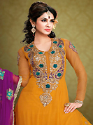 This season dazzle and shine in pure colors. The dazzling mustard georgette churidar suit have amazing embroidery patch work is done with resham, zari, sequins, stone and lace work. Beautiful embroidery work on kameez is stunning. The entire ensemble makes an excellent wear. Matching santoon churidar and purple dupatta is available with this suit. Slight Color variations are possible due to differing screen and photograph resolutions.