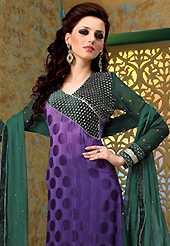 The glamorous silhouette to meet your most dire fashion needs. The dazzling shaded purple crepe jacquard churidar suit have amazing embroidery patch work is done with zari and stone work. The entire ensemble makes an excellent wear. Contrasting dark green santoon churidar and dark green chiffon dupatta is available with this suit. Slight Color variations are possible due to differing screen and photograph resolutions.