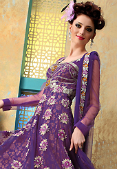 Take a look on the changing fashion of the season. The dazzling purple net churidar suit have amazing embroidery patch work is done with resham, zari, sequins, stone and lace work. The entire ensemble makes an excellent wear. Matching churidar and dupatta is available with this suit. Slight Color variations are possible due to differing screen and photograph resolutions.