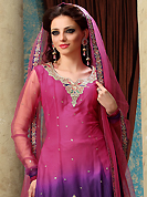 Look stunning rich with dark shades and floral patterns. The dazzling pink and purple net churidar suit have amazing embroidery patch work is done with resham, zari, sequins and stone work. The entire ensemble makes an excellent wear. Matching churidar and dupatta is available with this suit. Slight Color variations are possible due to differing screen and photograph resolutions.