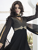 A desire that evokes a sense of belonging with a striking details. The dazzling black georgette readymade churidar suit have amazing embroidery and silk patch work is done with kasab, cutdana and lace work. Beautiful embroidery work on kameez is stunning. The entire ensemble makes an excellent wear. Matching santoon churidar and chiffon dupatta is available with this suit. Slight Color variations are possible due to differing screen and photograph resolutions.