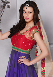 Take a look on the changing fashion of the season. The dazzling purple and red chanderi silk and brocade readymade churidar suit have amazing embroidery patch work is done with sequins, stone and kasab work. Beautiful embroidery work on kameez is stunning. The entire ensemble makes an excellent wear. Matching red santoon churidar and beige shimmer dupatta is available with this suit. Slight Color variations are possible due to differing screen and photograph resolutions.
