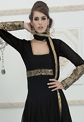 Look stunning rich with dark shades and floral patterns. The dazzling black georgette readymade churidar suit have amazing embroidery patch work is done with sequins and kasab work. Beautiful embroidery work on kameez is stunning. The entire ensemble makes an excellent wear. Matching santoon churidar and chiffon dupatta is available with this suit. Slight Color variations are possible due to differing screen and photograph resolutions.