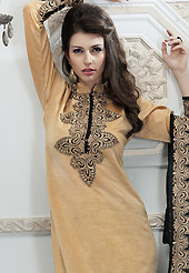 An occasion wear perfect is ready to rock you. The dazzling fawn jute silk readymade churidar suit have amazing embroidery patch work is done with resham work. Beautiful embroidery work on kameez is stunning. The entire ensemble makes an excellent wear. Contrasting black santoon churidar and black super net dupatta is available with this suit. Slight Color variations are possible due to differing screen and photograph resolutions.