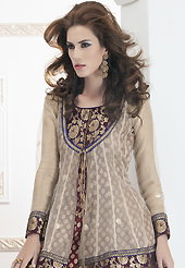Get ready to sizzle all around you by sparkling suit. The dazzling light fawn and maroon net and brocade readymade churidar suit have amazing embroidery patch work is done with resham and kasab work. Beautiful embroidery work on kameez is stunning. The entire ensemble makes an excellent wear. Contrasting royal blue santoon churidar and double dye net dupatta is available with this suit. Slight Color variations are possible due to differing screen and photograph resolutions.