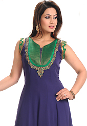 The glamorous silhouette to meet your most dire fashion needs. The dazzling navy blue faux georgette churidar suit have amazing embroidery and brocade bordered patch work is done with resham, sequins, stone, cutdana and kasab work. Beautiful embroidery work on kameez is stunning. Contrasting green churidar and dupatta is available with this suit. Slight Color variations are possible due to differing screen and photograph resolutions.