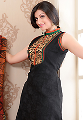 The fascinating beautiful subtly garment with lovely patterns. The dazzling black net jacquard churidar suit have amazing embroidery patch work is done with resham work. The entire ensemble makes an excellent wear. Contrasting red cambric cotton churidar and super net dupatta is available with this suit. Slight Color variations are possible due to differing screen and photograph resolutions.