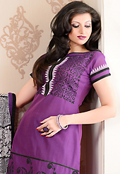 The most beautiful refinements for style and tradition. The dazzling purple chanderi silk churidar suit have amazing paisley, abstract, black print and patch work. The entire ensemble makes an excellent wear. Contrasting black cambric cotton churidar and off white chiffon dupatta is available with this suit. Slight Color variations are possible due to differing screen and photograph resolutions.