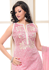 The glamorous silhouette to meet your most dire fashion needs. The dazzling pink chanderi silk churidar suit have amazing floral, paisley print and embroidery patch work is done with resham work. The entire ensemble makes an excellent wear. Contrasting off white cotton silk churidar and shaded chiffon dupatta is available with this suit. Slight Color variations are possible due to differing screen and photograph resolutions.